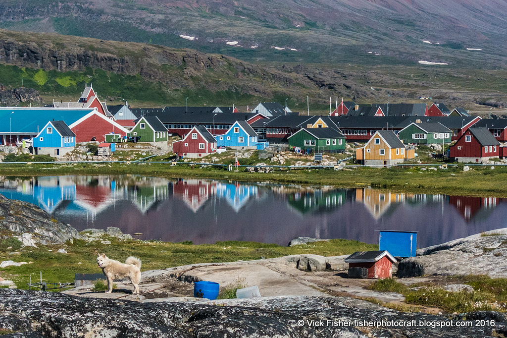 Greenland Greenlandic dogs Disko Island  village community homes lakes mountains reflection colorful