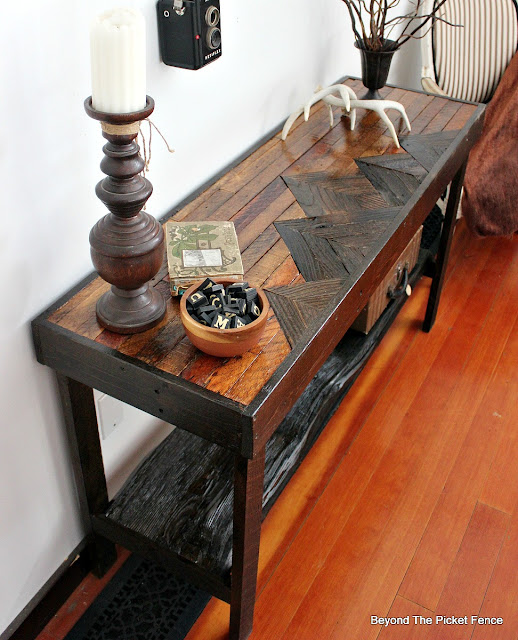 Sofa table made with four different types of reclaimed wood