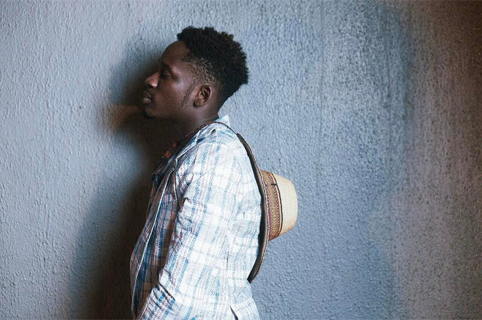 Mr Eazi rocks Ghana-must-go suit