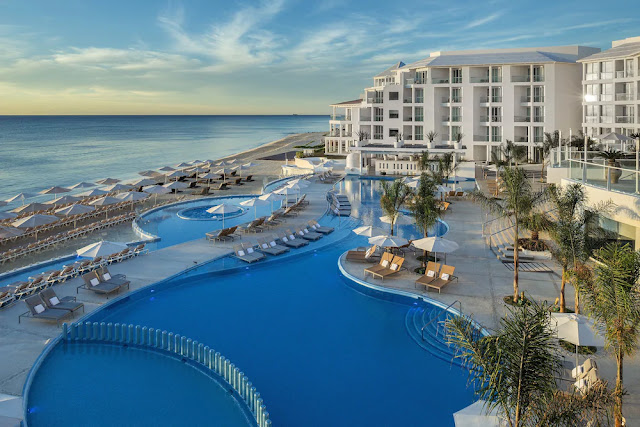 Playacar Palace All Inclusive, a resort for couples, families, and groups rests beside the glistening turquoise waters and powdery white sands of Playa del Carmen, a destination known for its laid back charm.