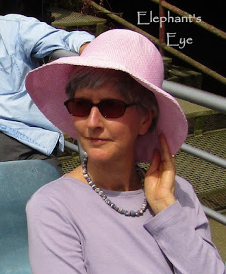 Pink hat on Thames cruise