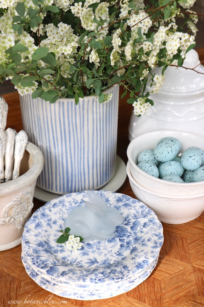 A fast and easy blue and white Easter tablescape started with bridal wreath spirea branches from the yar