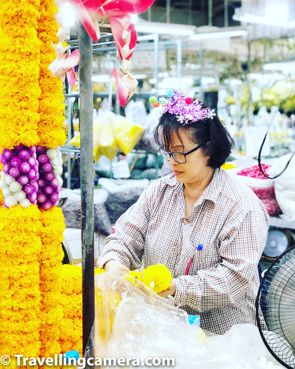 Above lady is making garlands and there were thousands of similar looking garlands in Pak Khlong Talat. Flower garlands are particular prevalent - they can be seen in temples, hanging from taxi rearview mirrors, at shrines, at weddings and used in a wide array of situations. Cars pull up at roadside sellers to purchase a fresh garland to hang in their vehicle to please their god good luck and protection on Thailand's chaotic roads. You would certainly notice use of flowers in restaurants and hotels you visit in Bangkok.     Related Blogpost - Google App for Cheaper & Reliable Commute in Thailand
