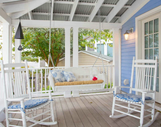 Coastal Cottage Porch with Swing Bench and Rocking Chairs