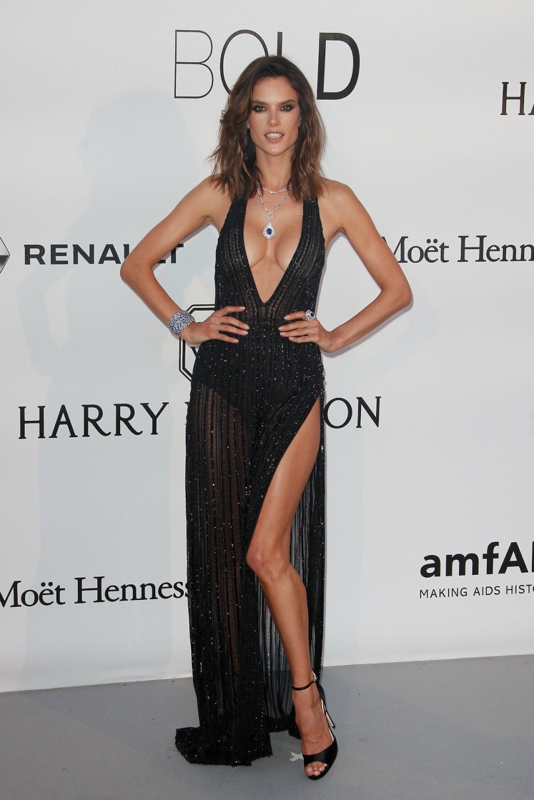 Alessandra Ambrosio opts to go braless in perilously plunging gown with dramatic thigh-slash at amfAR Gala