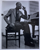 Photograph of Fela Sowande at a piano