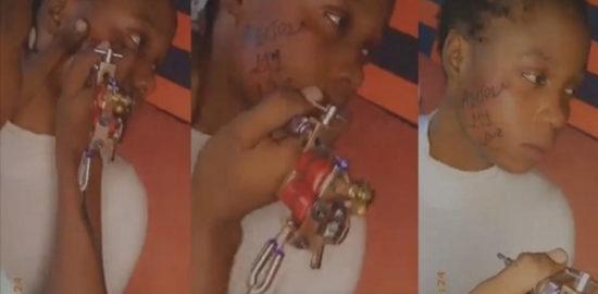 Nigerian-Girl-Tattoos-Boyfriend-Name-on-Her-Face-to-Prove-Her-Love-Video-Teelamford