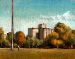 Oil painting of a figure standing by a light pole on a playing field, with trees and high-rise flats in the background.