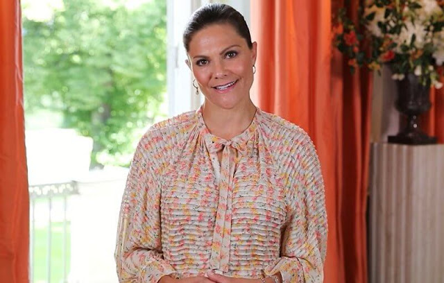 Crown Princess Victoria wore a daydream floral midi dress from Bytimo. Dulong Fine Jewelry bell pendants esme earrings