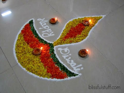 Diwali Special Diya Rangoli Design with marigold flowers How to make rangoli with flowers