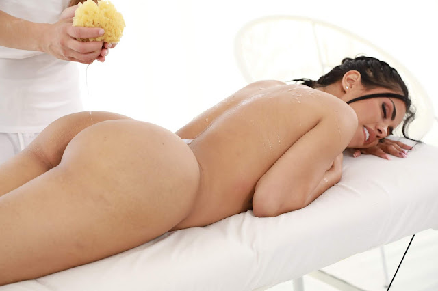 Canela Skin lying complete naked big booty oiled up sexy ass