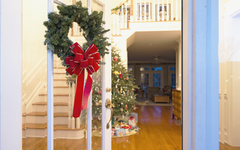 Foyer with hardwood flooring decorated for Christmas