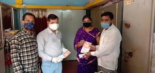 प्रधानमंत्री नरेंद्र मोदी के नेतृत्व में भाजपा सरकार के सात वर्ष पूरे होने पर माक्स वितरण कार्यक्रम किया
