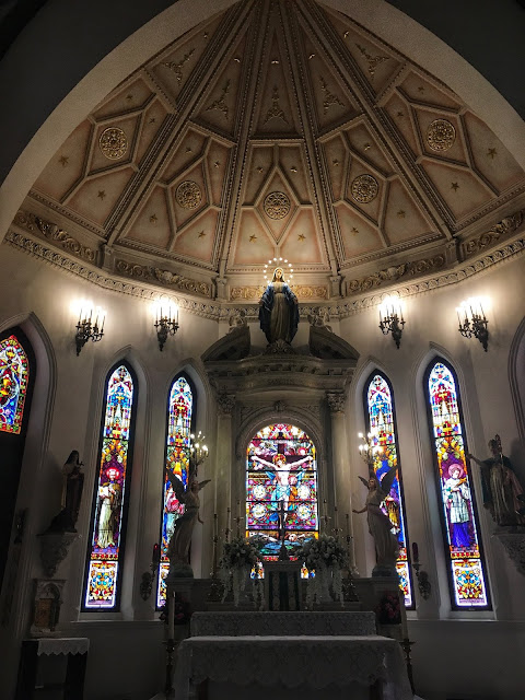 stained glass behind the altar