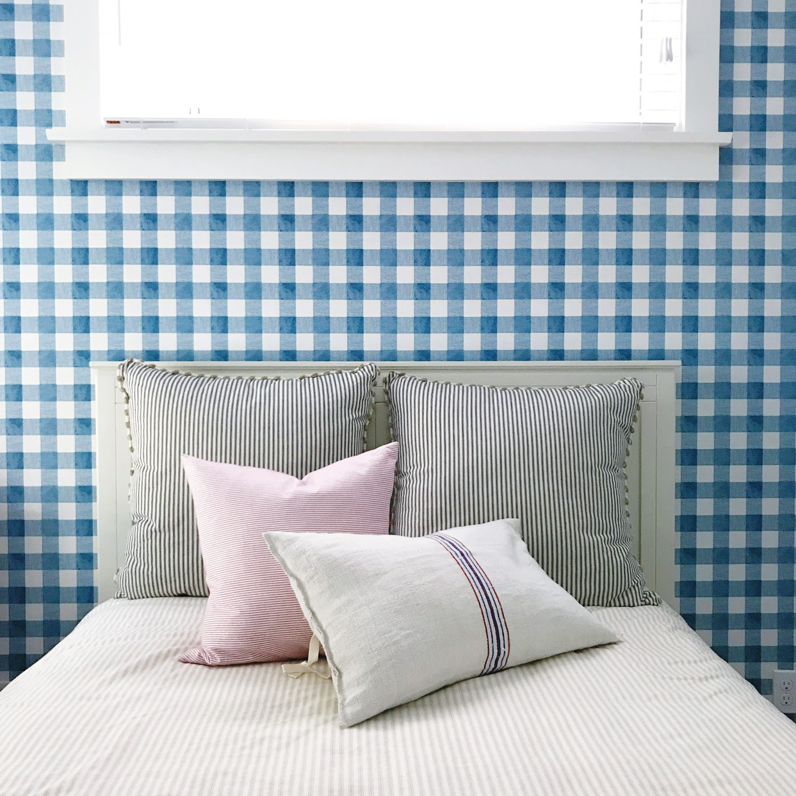 modern country cottage bedroom with gingham wallpaper