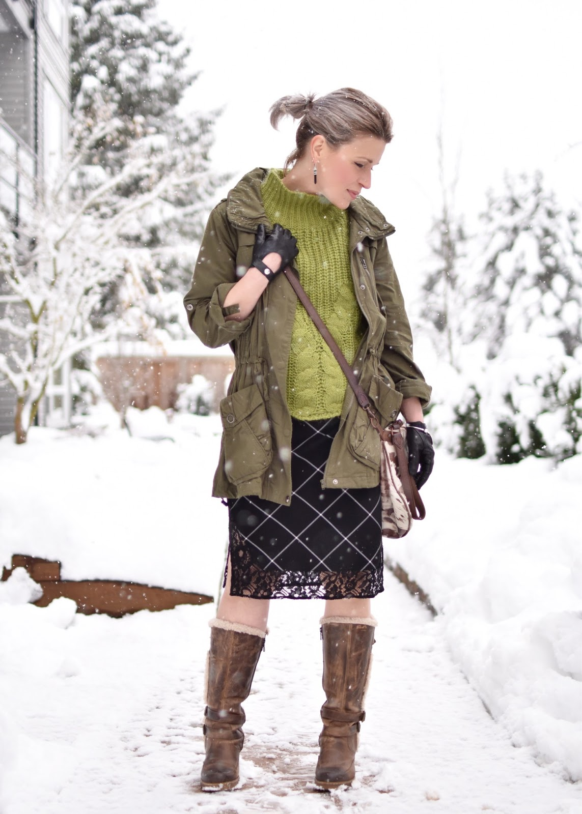 Monika Faulkner outfit inspiration - styling a plaid slipdress with a cropped sweater, army-inspired parka, and fleece-trimmed block-heeled boots