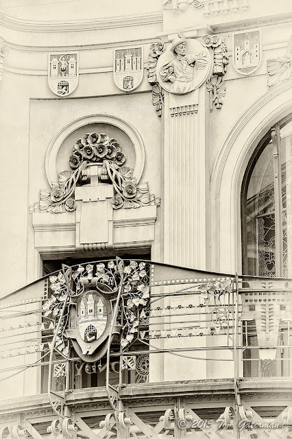 Detail image showing the upper level of Prague's Municipal House.
