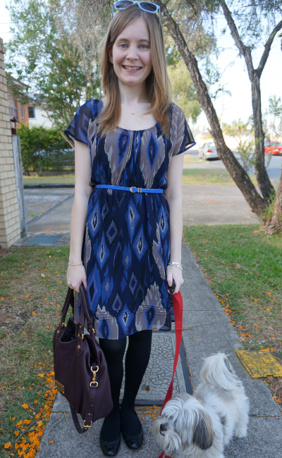 Jeanswest blue aztec print dress belted with black flats and tights
