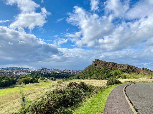 Salisbury Crags and city skyline viewed from Queen's Drive, Holyrood Park, Edinburgh, Scotland