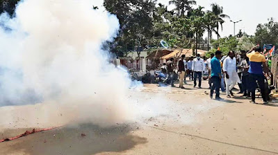 Trinamul supporters burst sound crackers to mark the launch of the campaign by Raiganj party nominee Kanaialal Agarwal