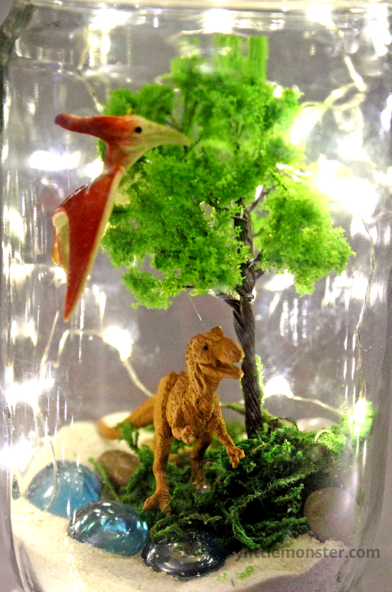 Dinosaur garden in a jar with lights