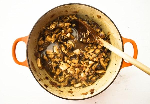 Sauteed mushrooms in a cast iron casserole pan