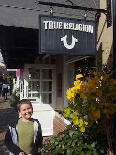 Dan Jon Jr outside of True Religion at Bicester Village