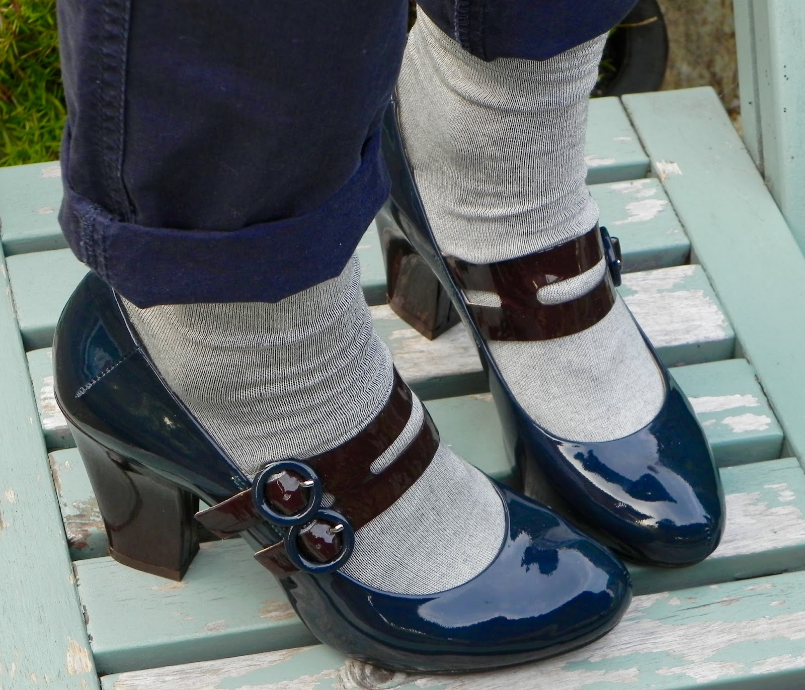 Petrol blue Clarks Mar-Jane shoes and socks.