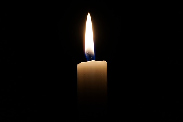single candle in the darkness
