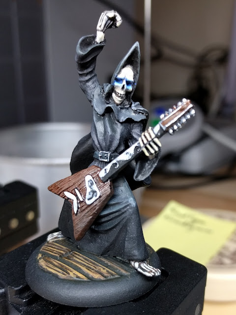 Death playing guitar fully painted