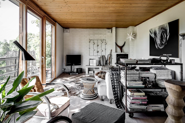 Scandinavian design villa with oriental and minimalist elements, cowhide chair, houseplants