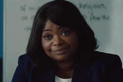 Movie still for Luce (2019) where Octavia Spencer in her classroom addressing concerns she has about her student's paper to Naomi Watts