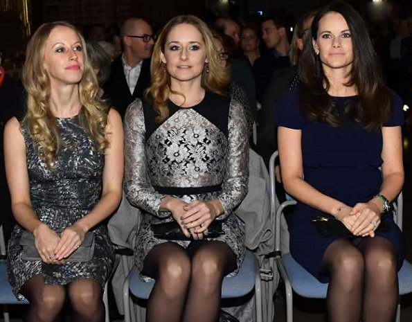 Princess Sofia, Sara Hellqvist and Lina Hellqvist at Christmas concert in Stockholm. Princess wore PRADA Knee length dress, Grece clutbag, gold bracelet, diamond rings and diamond gold earrings