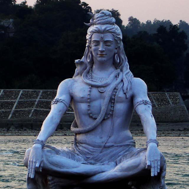 shiva statue ganga river bank rishikesh