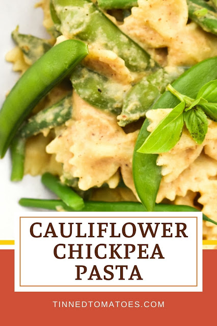 An incredibly easy creamy pasta sauce made with roasted cauliflower and chickpeas and served with green vegetables for a nice contrast.