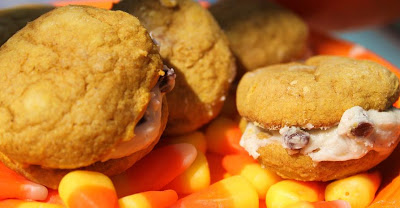 these are pumpkin whoppie pie baked with a cream cheese and chocolate chip filling