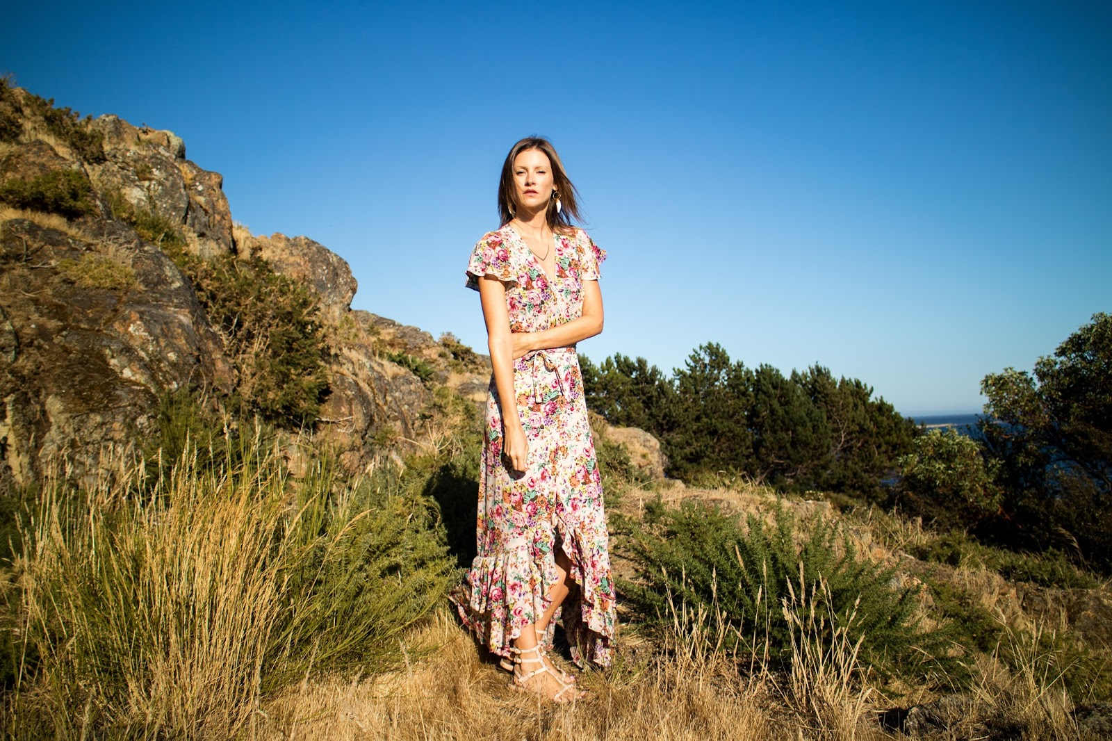 fashion blogger, Alison Hutchinson, is wearing an Auguste the label floral maxi dress and Sarah Mulder Jewelry