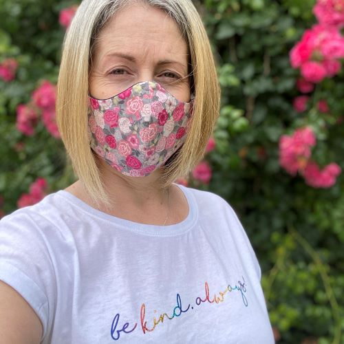 Photo is of me, wearing a mask, with slogan saying 'be kind. always!'