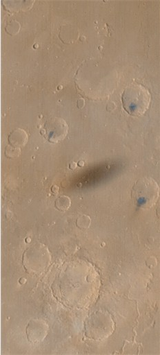 Phobos shadow on Martian surface, captured by Mars Global Surveyor in 1999