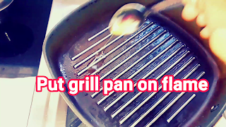 image of grill pan on flame