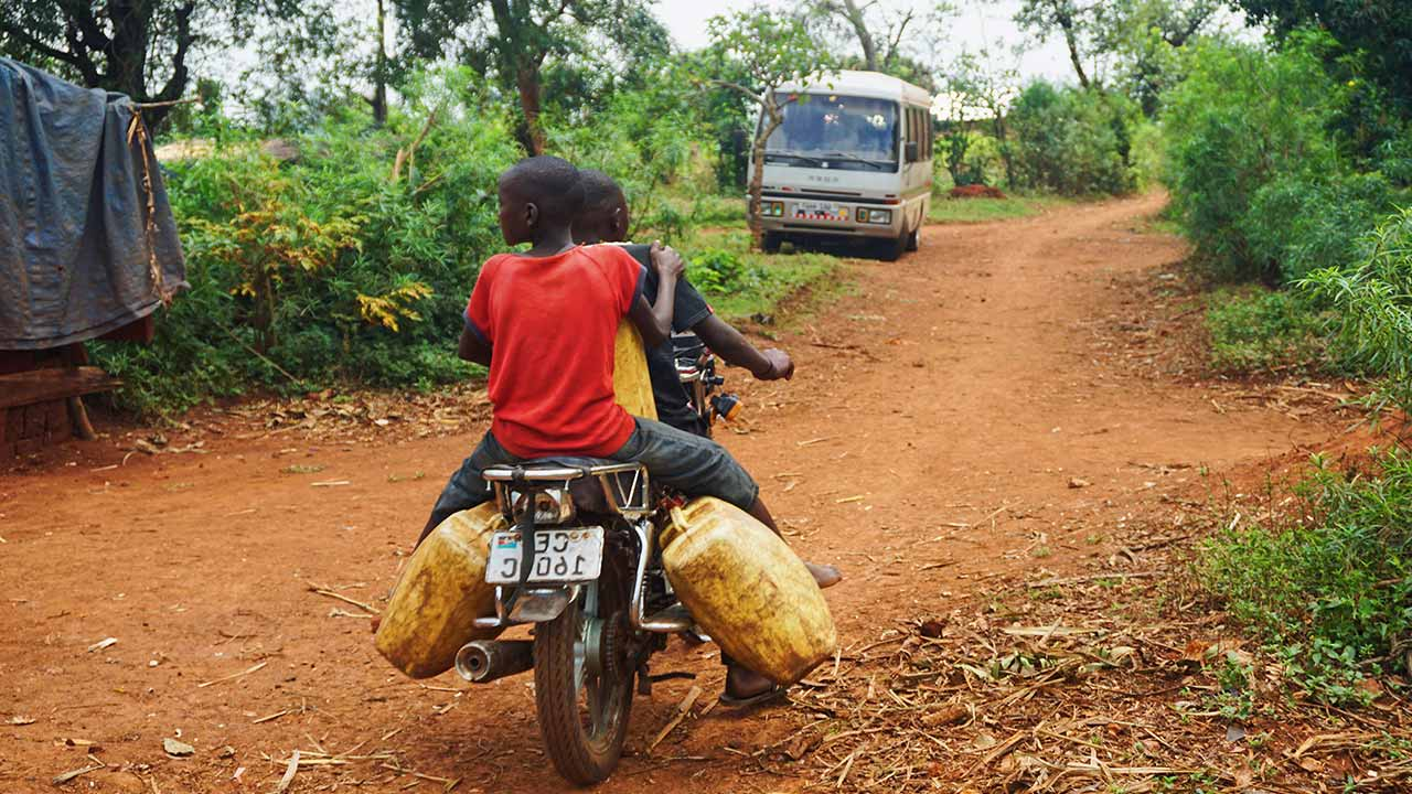 two men in motor in uganda most poorest nation in africa