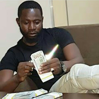 Nigerian man goes to bed with Dollar bills