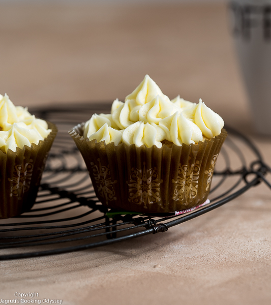 Eggless condensed milk cupcakes frosted with vanilla butter cream