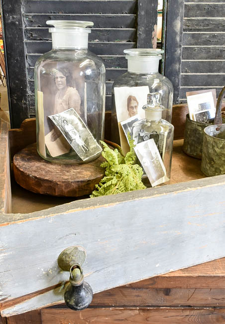 Vintage photos in apothecary jars