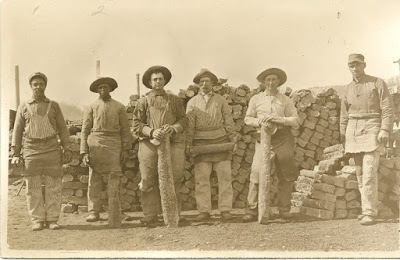 Group of six iron mining workers