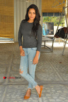 Actress Bhanu Tripathri Pos in Ripped Jeans at Iddari Madhya 18 Movie Pressmeet  0069.JPG