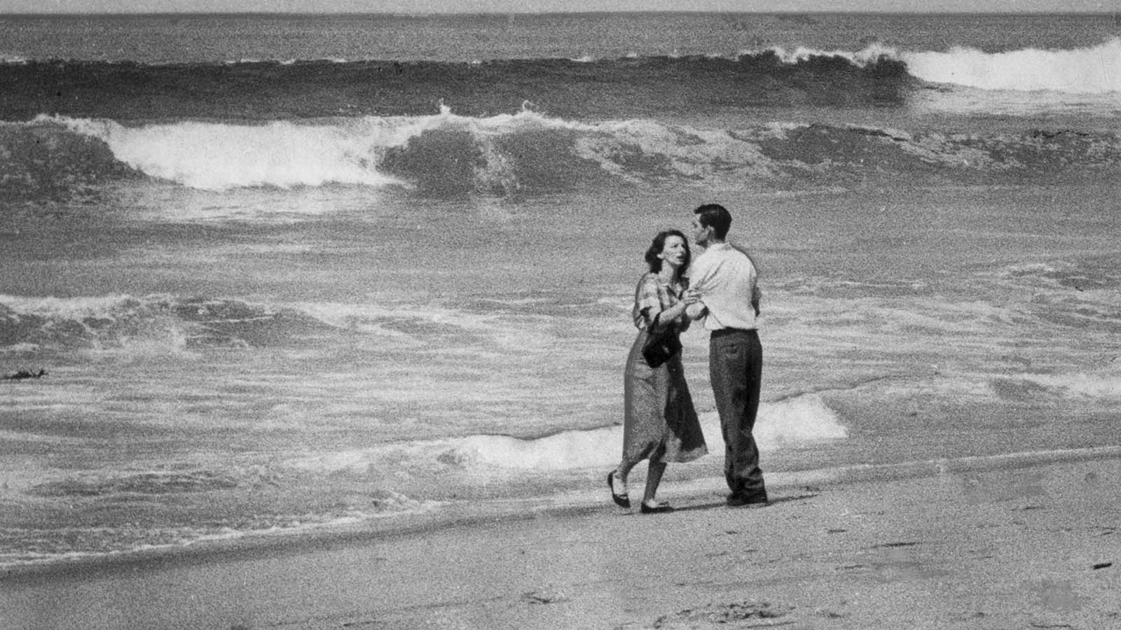 April 2, 1954: A couple are photographed moments after learning that their 19-month-old child had been swept out to sea at Hermosa Beach.