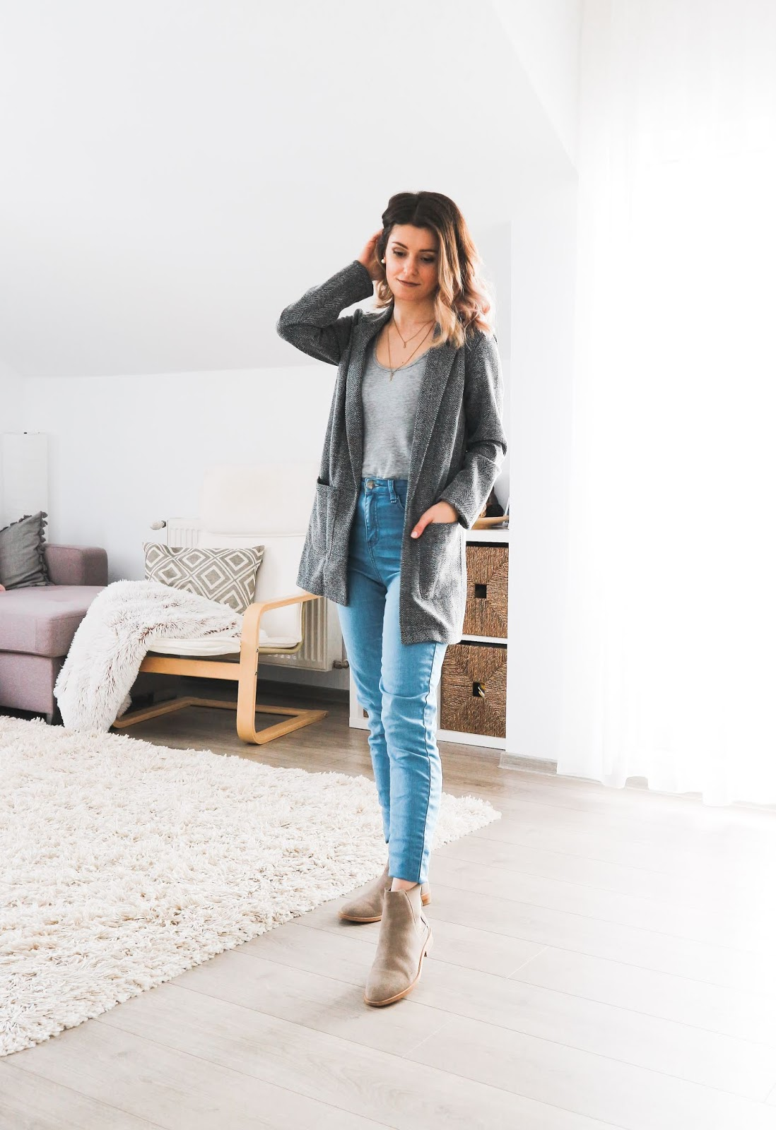grey blazer with jeans and camel boots outfit