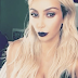Kim K took to Snapchat to show off her blonde weave/wig and dark lipstick