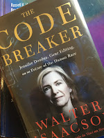 The Code Breaker, by Walter Isaacson, superimposed on Intermediate Physics for Medicine and Biology.